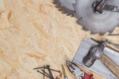 Tools set on osb panel with copy space. Carpenter workplace on wooden background. Top view.  stock photography