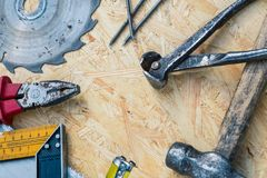 Tools set on osb panel with copy space. Carpenter workplace on wooden background. Top view.  stock photos