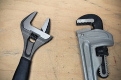 Tools set in vintage picture style . set of hand tools on a wooden background, Wrench tools or Pipe wrench for hard work Stock Image