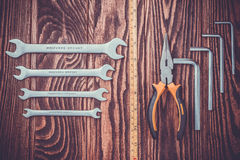 Tools set on a wooden background Royalty Free Stock Images