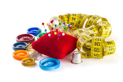 Tools for sewing: button, thimble, pins Royalty Free Stock Images