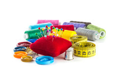 Tools for sewing: button, thimble, pins Royalty Free Stock Photo