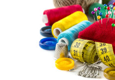 Tools for sewing: button, thimble, pins Royalty Free Stock Photos