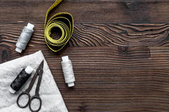 Tools for sewing for hobby set on wooden background top view mock up Royalty Free Stock Image