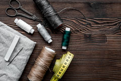 Tools for sewing for hobby set on wooden background top view mock up Stock Images