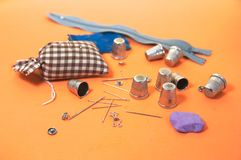 Tools for sewing on an orange background royalty free stock photo
