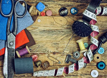 Tools for sewing on wooden table Stock Photo