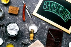 Tools for shaving in barbershop on workplace background top view Royalty Free Stock Images