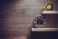 Tools and shelf at brown background. Tools and wooden shelf at brown background stock photography