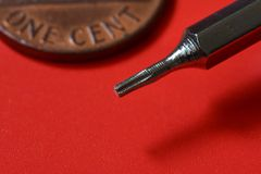 Tools, small philips screwdriver on red background Stock Image