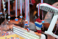 Tools and/or souvenirs of. BANGKOK THAILAND - FEBRUARY 9, 2014 : Whistles and national flag tri-coloured ribbons, Tools and/or souvenirs of Bangkok Shutdown Royalty Free Stock Photo