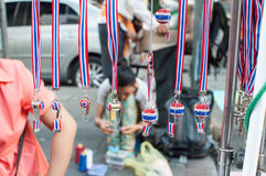 Tools and/or souvenirs of. BANGKOK THAILAND - FEBRUARY 9, 2014 : Whistles and national flag tri-coloured ribbons, Tools and/or souvenirs of Bangkok Shutdown Royalty Free Stock Images