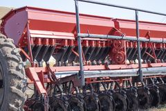 Tools for sowing grain on wheels stock image