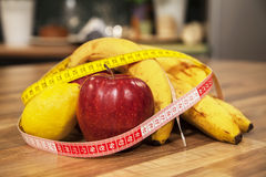 Tools for successful dieting. Tape measure and fruits. Royalty Free Stock Photography