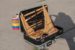 The tools are in the suitcase. A street performer from Peru performs Latin music on traditional instruments on the street Royalty Free Stock Photo
