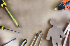 Tools supplies and paintbrush on blank brown background Stock Photography