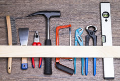 Tools on table. Image shows a set of tools on wooden table top view royalty free stock photo