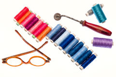Tools for tailor. Multi colored yarns and tools to tailor Stock Image