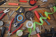 Tools on a timber floor, the top view. Royalty Free Stock Images