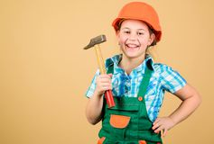 Tools to improve yourself. Builder engineer architect. Future profession. Kid builder girl. Build your future yourself. Initiative child girl hard hat helmet royalty free stock photos