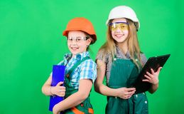 Tools to improve yourself. Repair. Future profession. Builder engineer architect. Kid worker in hard hat. Child care. Development. small girls repairing stock images