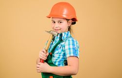 Tools to improve yourself. Repair. Future profession. Builder engineer architect. Kid worker in hard hat. Child care. Development. small girl repairing with stock photos