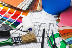 Tools to repair the premises and drawing plans Royalty Free Stock Photography