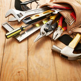 Tools in tool belt. On wood planks royalty free stock photos