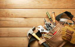 Tools in tool belt. On wood planks with copy space stock images