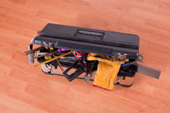 Tools in tool box on wooden floor Royalty Free Stock Photography