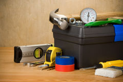 Tools and toolbox on wood Stock Image