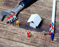 Tools, toy people and paper Royalty Free Stock Images