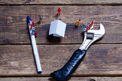 Tools, toy people and paper Stock Photography