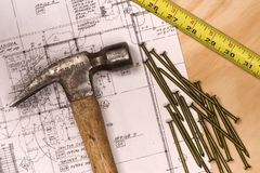 Tools of the trade. Closeup image of a set of house plans and carpenters tools royalty free stock image