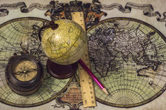 Tools traveler - Compass, globe, map, pencil, ruler. Preparing for the season of travel Stock Photos