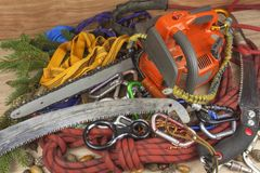 Tools for trimming trees, utility arborists. Chainsaw, rope and carabiners to work lumberjack Stock Image