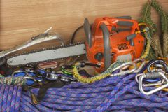 Tools for trimming trees, utility arborists. Chainsaw, rope and carabiners to work lumberjack Royalty Free Stock Image
