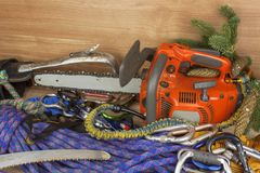 Tools for trimming trees, utility arborists. Chainsaw, rope and carabiners to work lumberjack Royalty Free Stock Images