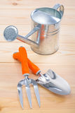 Tools trowel fork and watering can Royalty Free Stock Photography
