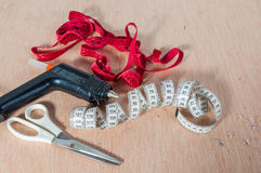 Tools for upholstering. Fabric, metro, scissors Royalty Free Stock Photos