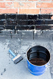 Tools for waterproofing. Stock Photography
