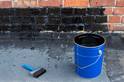 Tools for waterproofing. Royalty Free Stock Image