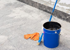 Tools for waterproofing. Royalty Free Stock Photography