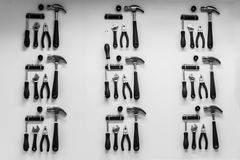 Tools on white wall. Tools on the wall Royalty Free Stock Photo