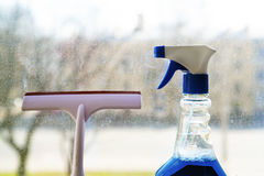 Tools for window cleaning. Cleaning spray and squeegee on a dirty window background Stock Photography
