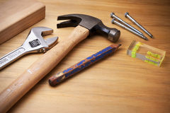 Tools On Wood Background. A still-life of tools on a plywood background Royalty Free Stock Images