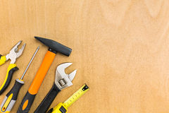 Tools on the wood background Stock Photos