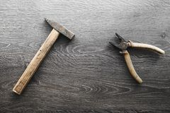 Tools on wood panel background.  Royalty Free Stock Images