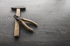 Tools on wood panel background Stock Photo