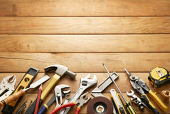 Tools on wood planks. Variety of tools on wood planks with copy space Royalty Free Stock Photography